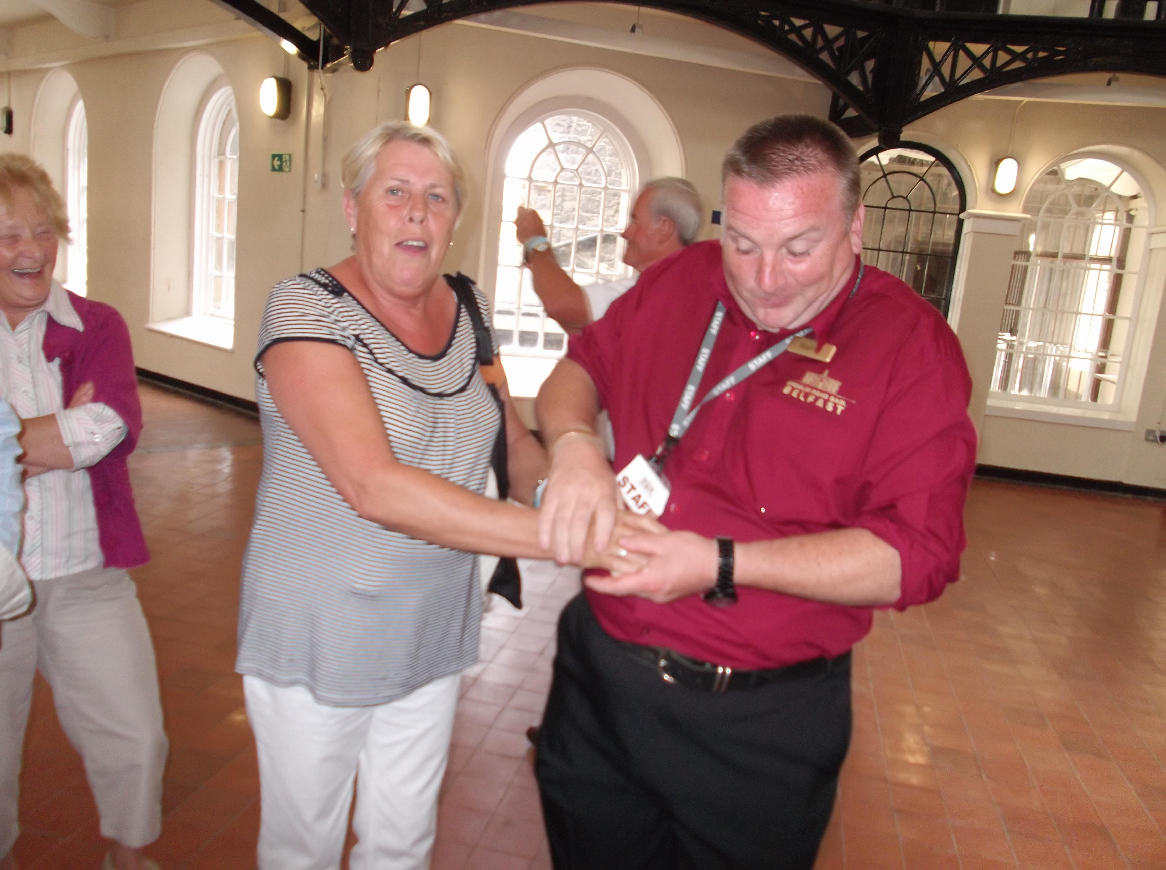 June being cuffed at the Gaol sc